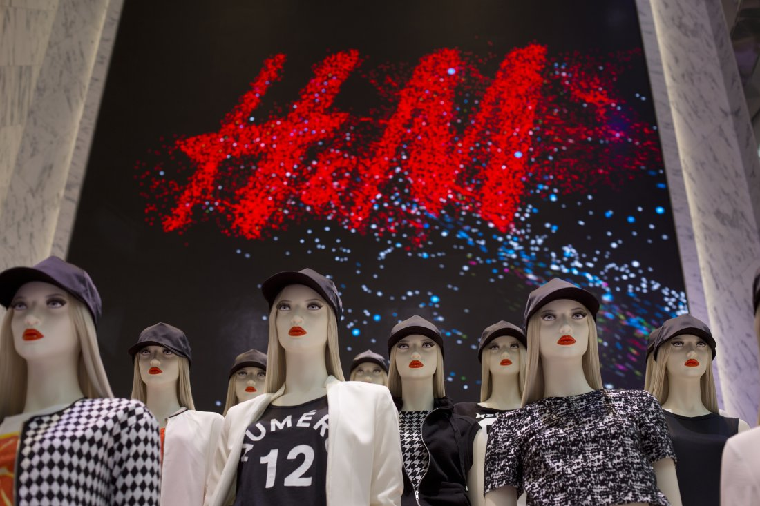 Women's clothing is displayed on mannequins during the grand opening of the Hennes & Mauritz AB (H&M) flagship store in New York, U.S., on Thursday, July 17, 2014. At 57,000 square feet, the new flagship located at 589 Fifth Avenue is the worlds largest H&M store. Photographer: Victor J. Blue/Bloomberg via Getty Images